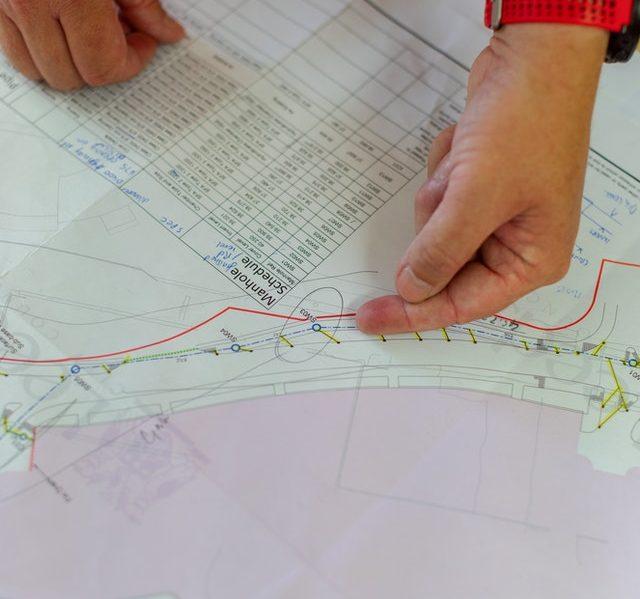 civil-engineer-looking-at-blueprint-3862628